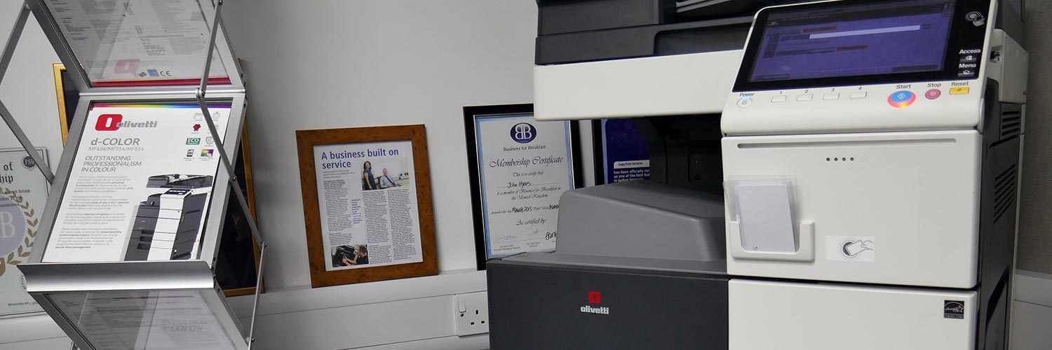 photocopier in an office with olivetti leaflets to the left